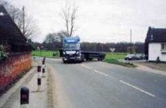 lorry emerging from side road