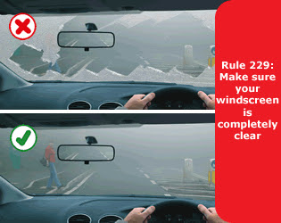clearing-ice-from-windscreen
