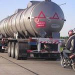 tanker followed by a motorbike