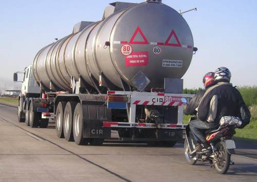 tanker followed by a motorbike