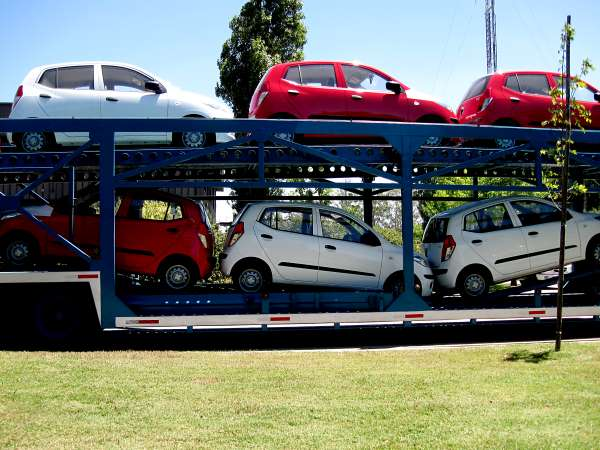 Cars waiting on a car transporter