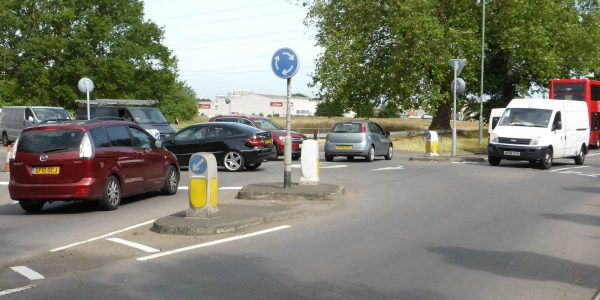 Mini roundabouts like this are just painted so that long vehicles have no problem negotiating them