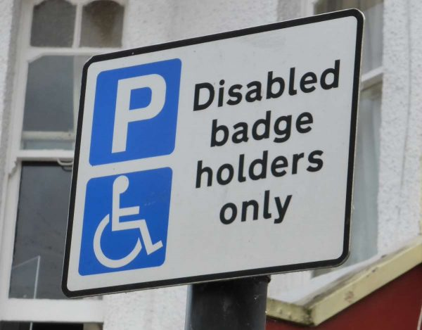 If you have a blue badge then you will be able to use spaces marked with this disabled badge holders sign