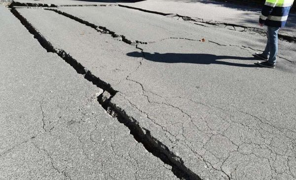 Cracks in the road appeared after an earthquake
