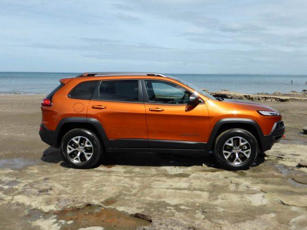 jeep on rocks on beach
